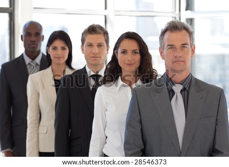 Young positive Business team looking at camera - stock photo