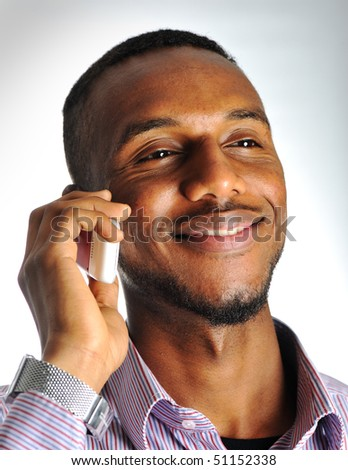 Young positive man talking on phone - stock photo