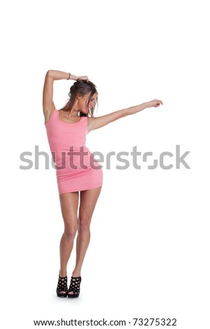 Young positive woman dancing in pink dress. Isolated over white background - stock photo