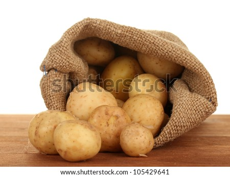 young potatoes in a sack on a table on white background close-up