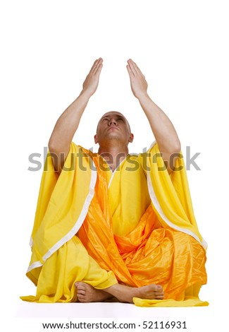 Young praying Buddhist monks. Isolated on white background