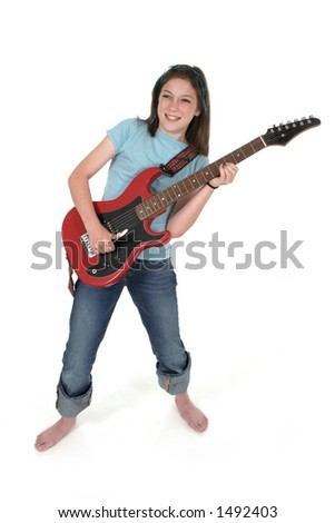 Young pre teen girl playing a red electric guitar.