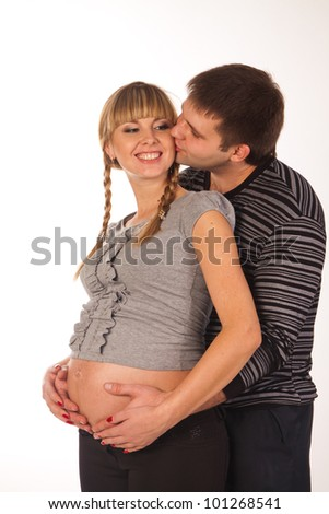 Young pregnant couple. Isolated on white background.