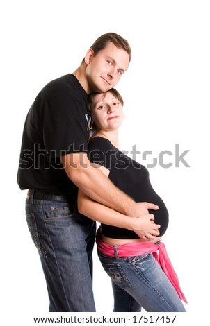 young pregnant woman and her husband - stock photo