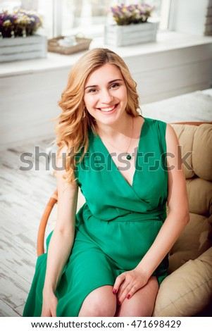 Young pregnant woman in chair