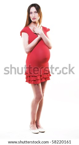 Young pregnant woman in red dress