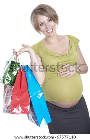 Young pregnant woman shopping while expecting baby - stock photo