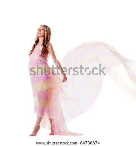 Young pregnant woman walk with fly veil - stock photo