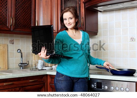Young pregnant woman with her laptop at home. - stock photo