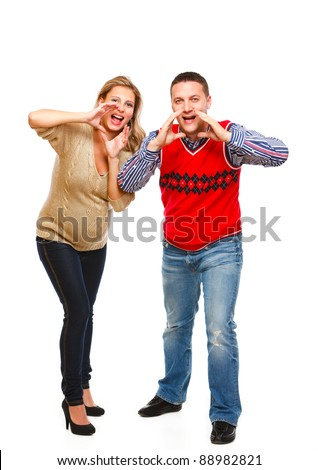 Young pregnant woman with husband shouting through megaphone shaped hand on white background - stock photo