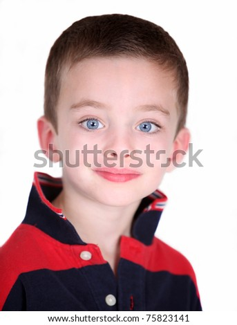 Young preschool boy isolated on white - close-up portrait