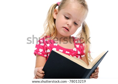 young preschool child learns while reading a book, isolated on white - stock photo