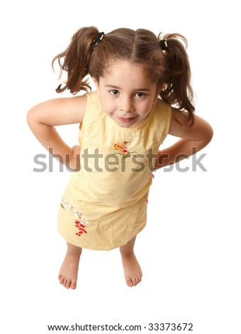 Young preschool girl standing with her hands on her hips - stock photo