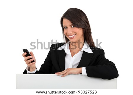 Young presenting a mobile phone - stock photo