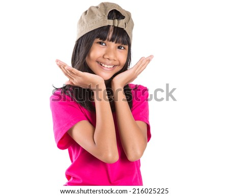 Young preteen Asian girl with a cap over white background - stock photo