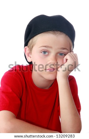 Young preteen boy with bored expression on face, isolated on white. - stock photo