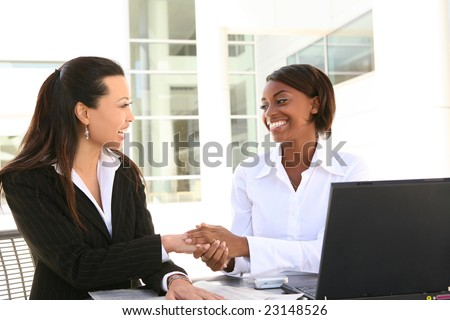Young pretty and diverse women business team at office - stock photo