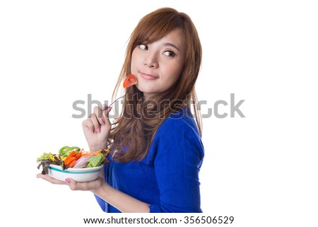 Young pretty asian  girl eating fresh vegetable salad with fork, isolated on white background