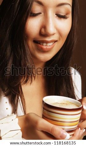 young pretty asian woman drinking coffee - stock photo