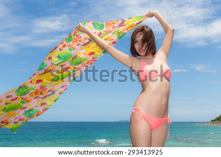 Young Pretty Asian woman posing on the beach . - stock photo