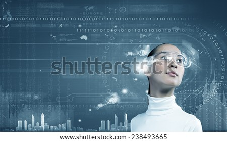 Young pretty asian woman touching digital hologram - stock photo