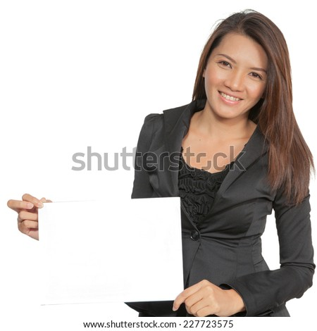 Young pretty attractive brunette Asian businesswoman standing positive showing blank signboard, isolated on white background - stock photo