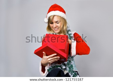 Young pretty blond Christmas woman with present