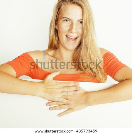 young pretty blond woman holding blank white board with copyspace isolated close up smiling - stock photo