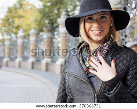 young pretty blond woman in stylish hat, street fashion european cold weather, city life holiday