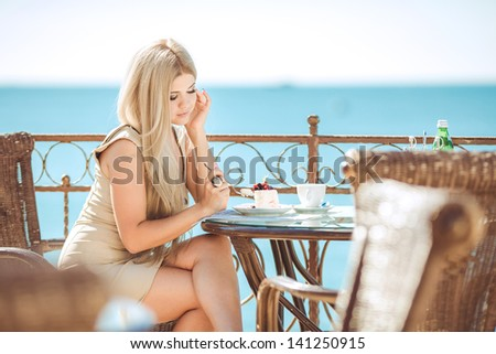 Young pretty blonde woman outdoors portrait. Soft sunny colors.