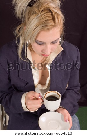 Young pretty blondie woman drinking coffee with milk