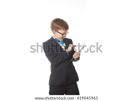 Young pretty boy posing at studio as a fashion model. Photo of preschooler 9 years old isolated on over white background with ipad - stock photo