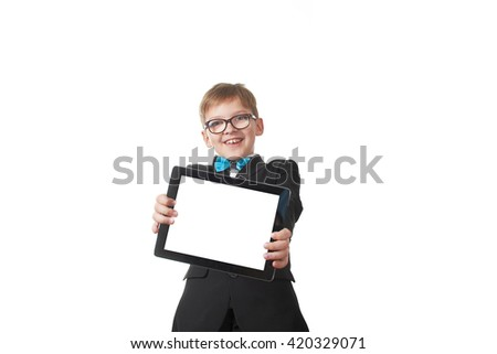 Young pretty boy posing at studio as a fashion model. Photo of preschooler 9 years old isolated on over white background with tablet - stock photo