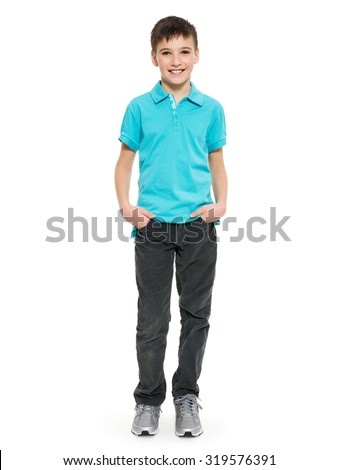 Young pretty boy posing at studio as a fashion model. Photo of preschooler 8 years old over white background - stock photo