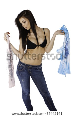 Young pretty brunette choosing what to put on - stock photo