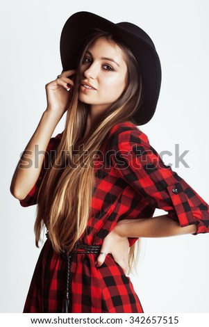 young pretty brunette girl hipster in hat on white background casual close up dreaming smiling - stock photo