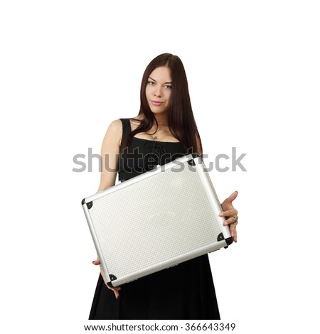 Young pretty brunette woman in black dress with silver white attache case in hands stands isolated on white background in square
