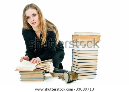 young pretty business lady on the floor among books