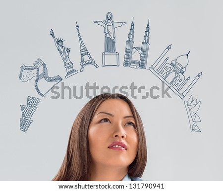 Young pretty business woman dreaming about vacation and her trip to famous touristic destination. Architecture symbols overhead