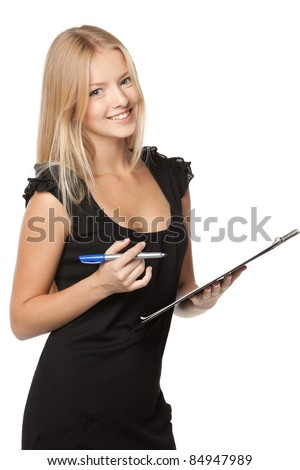 Young pretty business woman making notes on a clipboard over white background - stock photo