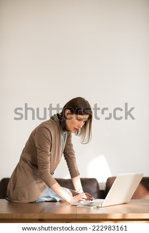 Young pretty business woman with laptop in the office