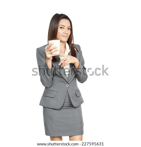 Young pretty businesswoman attractive beautiful asian model brunette smiling enjoy drinking coffee on white background - stock photo