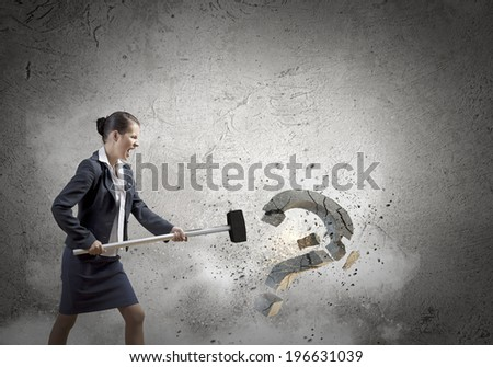 Young pretty businesswoman crashing stone question symbol - stock photo