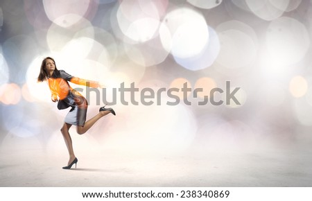 Young pretty businesswoman running in a hurry - stock photo