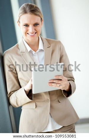 young pretty businesswoman with tablet computer - stock photo