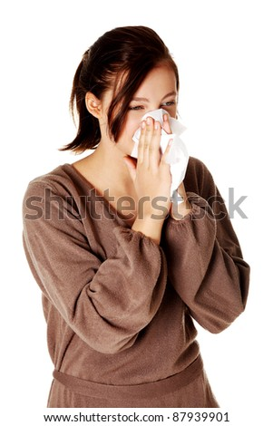 Young pretty caucasian girl blowing her nose. - stock photo
