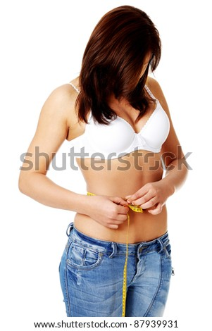 Young pretty caucasian girl giving injection herself. Isolated on white.