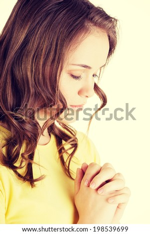 Young pretty caucasian girl praying. - stock photo