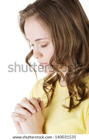 Young pretty caucasian girl praying over white background. - stock photo