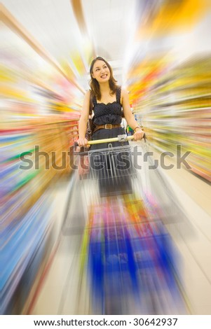 young pretty caucasian lady shopping indoor with zoom motion blur - stock photo
